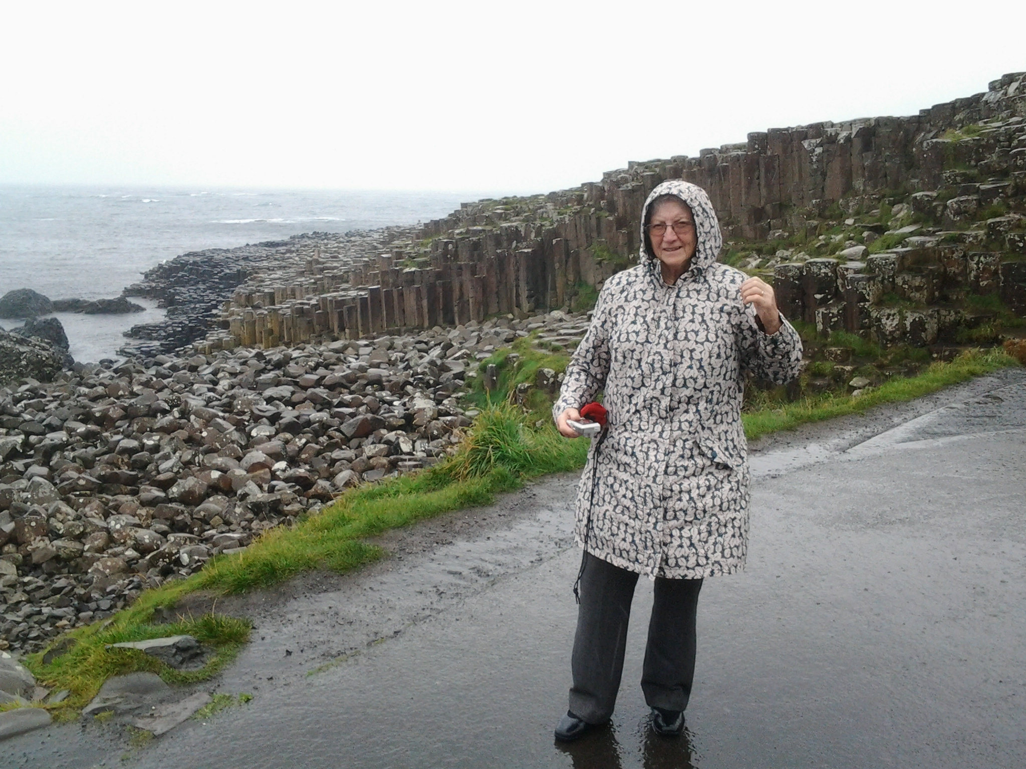 Peggy Carter braves the elements at the Giant's Causeway